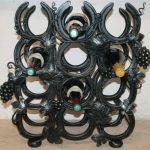 Grapevine winerack rack made with reclaimed horseshoes