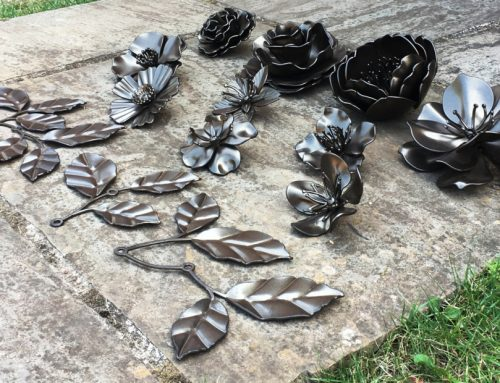 Handcrafted Stainless Steel flowers & leafs made for a prime development in London.
