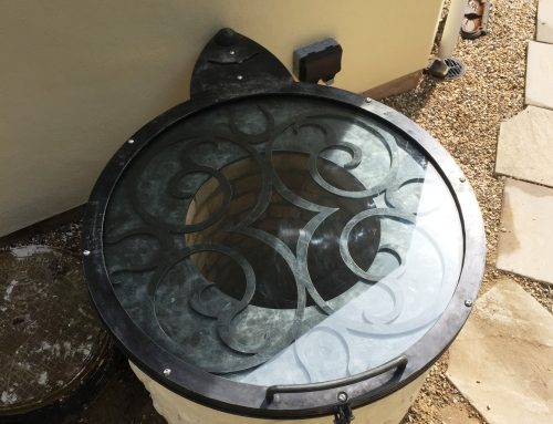 Bespoke pivoting well cover by West Country Blacksmiths
