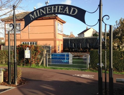 Minehead and Morrisons heritage link arch and secret stories walks signs.